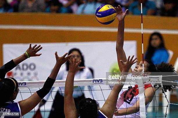 Karla Ortiz of Peru plays the ball against Yessica Paz of Venezuela during a match between Peru and Venezuela in women's volleyball as part of the...