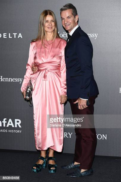 Karla Otto and Alexander Werz walk the red carpet of amfAR Gala Milano on September 21 2017 in Milan Italy