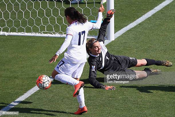 Karla Villalobos of Costa Rica scores a goal against Karly Gustafson of Puerto Rico in the first half during the Group A 2016 CONCACAF Women's...