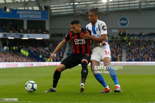 Karlan Grant of Huddersfield Town and Bernardo of Brighton Hove Albion during the Premier League match between Brighton Hove Albion and Huddersfield...