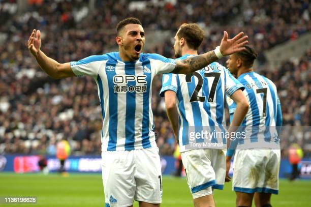 Karlan Grant of Huddersfield Town celebrates after scoring his team's third goal during the Premier League match between West Ham United and...