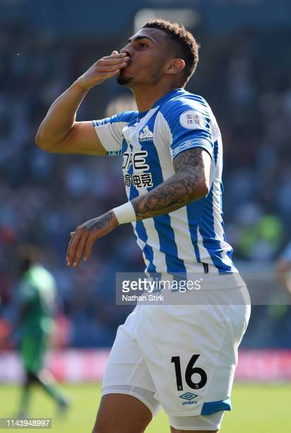 Karlan Grant of Huddersfield Town celebrates after scoring his team's first goal during the Premier League match between Huddersfield Town and...