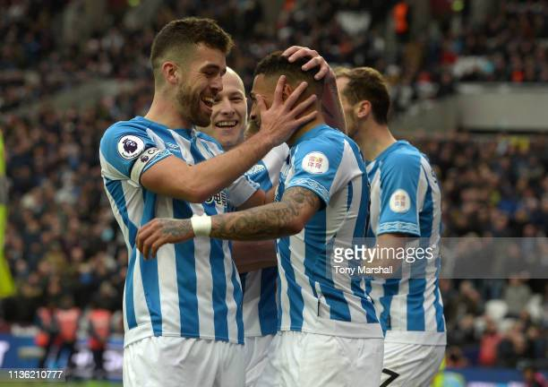 Karlan Grant of Huddersfield Town celebrates scoring thier third goal during the Premier League match between West Ham United and Huddersfield Town...