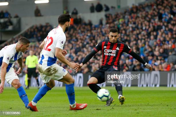 Karlan Grant of Huddersfield Town Martin Montoya and Anthony Knockaert of Brighton Hove Albion during the Premier League match between Brighton Hove...