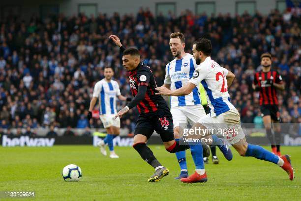 Karlan Grant of Huddersfield Town Martin Montoya and Dale Stephens of Brighton Hove Albion during the Premier League match between Brighton Hove...