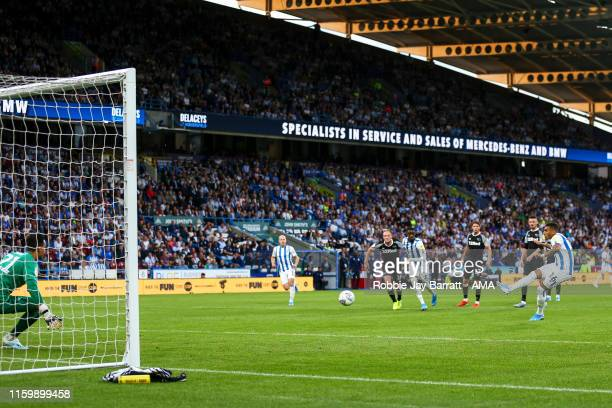 Karlan Grant of Huddersfield Town scores a goal to make it 1-2 during the Sky Bet Championship match between Huddersfield Town and Derby County at...