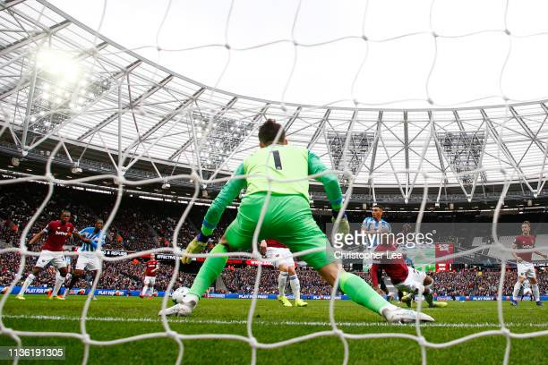 Karlan Grant of Huddersfield Town scores his team's second goal during the Premier League match between West Ham United and Huddersfield Town at...