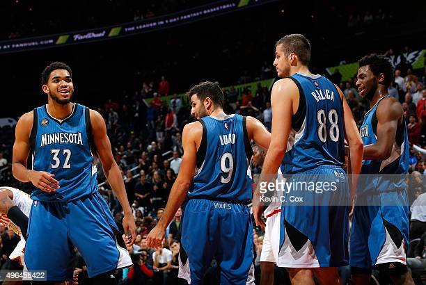 KarlAnthony Towns and Andrew Wiggins of the Minnesota Timberwolves react after Ricky Rubio draws a charge from Kent Bazemore of the Atlanta Hawks at...