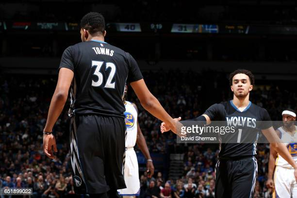 KarlAnthony Towns and Tyus Jones of the Minnesota Timberwolves high five each other during the game against the Golden State Warriors on March 10...