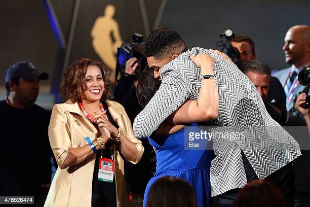 Karl-Anthony Towns celebrates after being drafted first overall by the Minnesota Timberwolves in the First Round of the 2015 NBA Draft at the...
