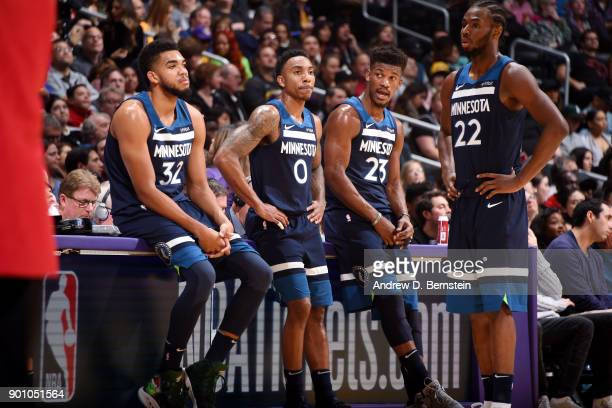 KarlAnthony Towns Jeff Teague Jimmy Butler and Andrew Wiggins of the Minnesota Timberwolves look on during the game against the Los Angeles Lakers on...
