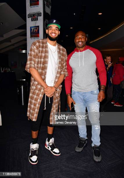 KarlAnthony Towns Jr and Brandon Jacobs attend Top Rank VIP party prior to the WBO welterweight title fight between Terence Crawford and Amir Khan at...