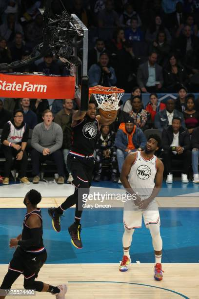KarlAnthony Towns of Team LeBron completes and alleyoop dunk against Joel Embiid of Team Giannis during the 2019 NBA AllStar Game on February 17 2019...