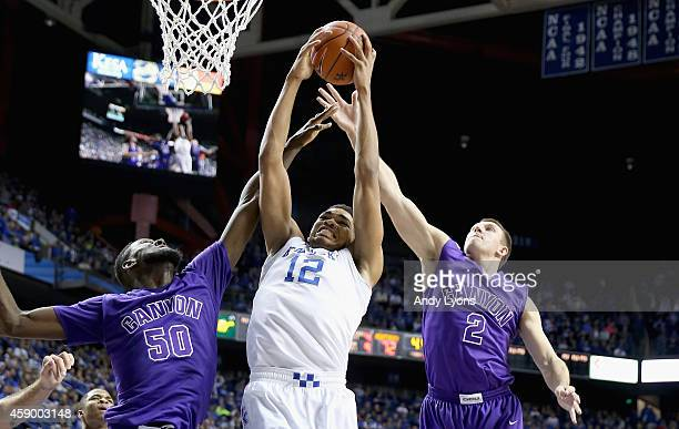 KarlAnthony Towns of the Kentucky Wildcats battles with Tobe Okafor and Joshua Braun of Grand Canyon Antelopes for a rebound at Rupp Arena on...