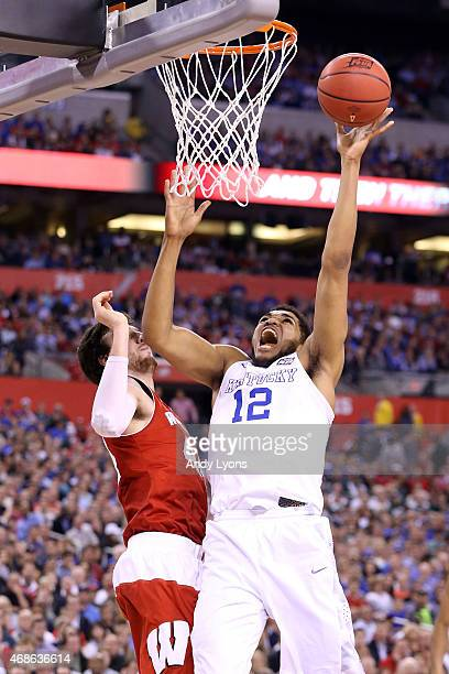 KarlAnthony Towns of the Kentucky Wildcats drives to the basket against Frank Kaminsky of the Wisconsin Badgers in the second half during the NCAA...