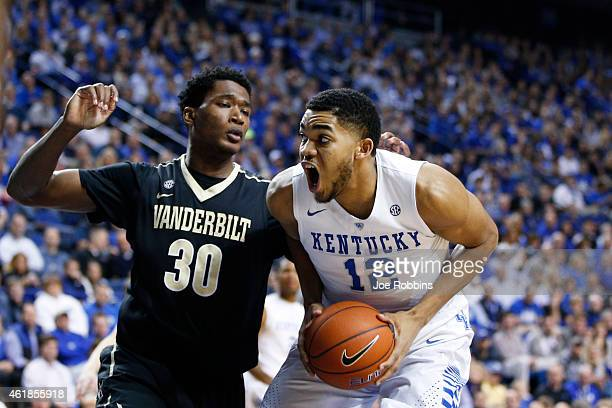 KarlAnthony Towns of the Kentucky Wildcats goes to the basket against Damian Jones of the Vanderbilt Commodores in the first half of the game at Rupp...