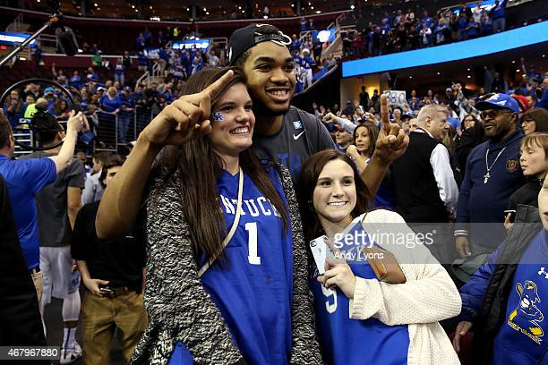 Karl-Anthony Towns of the Kentucky Wildcats poses with fans after defeating the Notre Dame Fighting Irish during the Midwest Regional Final of the...