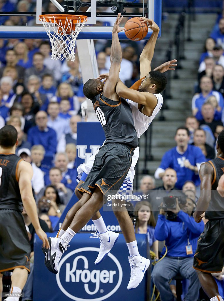 Karl-Anthony Towns #12 of the Kentucky Wildcats shoots the ball while defended by Jonathan Holmes #10 of the Texas Longhorns at Rupp Arena on December 5, 2014 in Lexington, Kentucky.