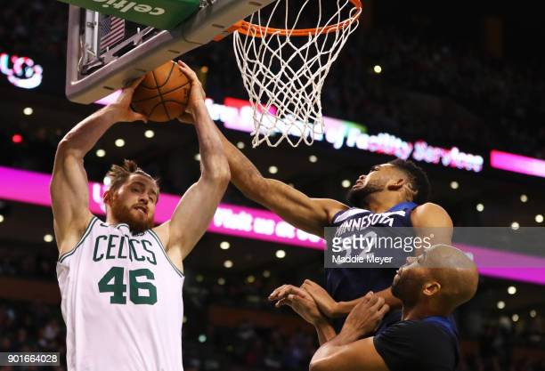 KarlAnthony Towns of the Minnesota Timberwolves and Aron Baynes of the Boston Celtics battle for a rebound during the second quarter at TD Garden on...