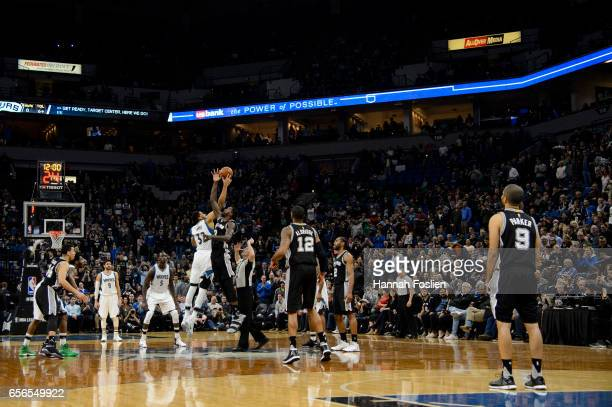 KarlAnthony Towns of the Minnesota Timberwolves and Dewayne Dedmon of the San Antonio Spurs tipoff to start the game on March 21 2017 at the Target...
