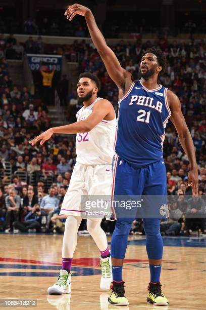 KarlAnthony Towns of the Minnesota Timberwolves and Joel Embiid of the Philadelphia 76ers are seen after a shot during the game on January 15 2019 at...