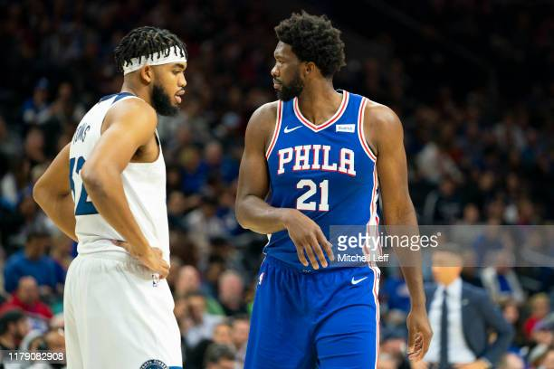 KarlAnthony Towns of the Minnesota Timberwolves and Joel Embiid of the Philadelphia 76ers look on in the first quarter at the Wells Fargo Center on...