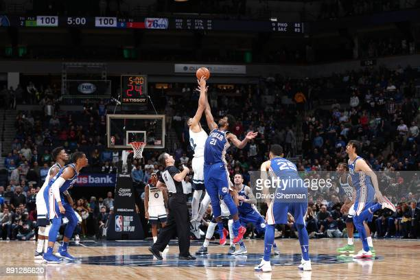 KarlAnthony Towns of the Minnesota Timberwolves and Joel Embiid of the Philadelphia 76ers tipoff for overtime on December 12 2017 at Target Center in...