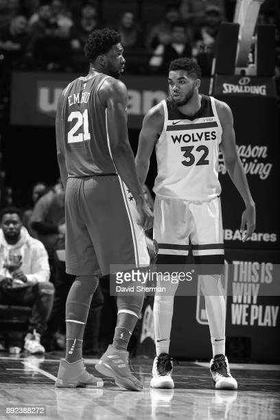 KarlAnthony Towns of the Minnesota Timberwolves and Joel Embiid of the Philadelphia 76ers stand on the court during the game on December 12 2017 at...