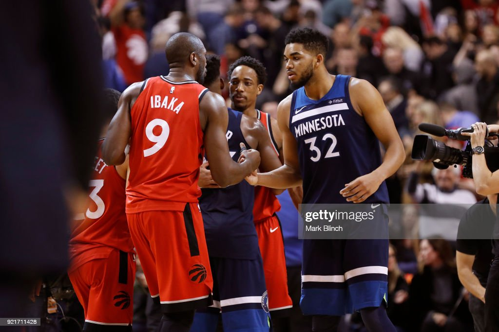 Karl-Anthony Towns #32 of the Minnesota Timberwolves and Serge Ibaka #9 of the Toronto Raptors high five after the game on January 30, 2018 at the Air Canada Centre in Toronto, Ontario, Canada.