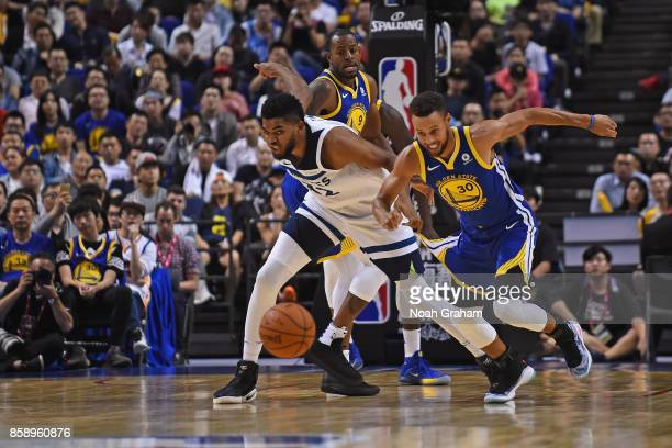 KarlAnthony Towns of the Minnesota Timberwolves and Stephen Curry of the Golden State Warriors go for a loose ball during the game as part of 2017...