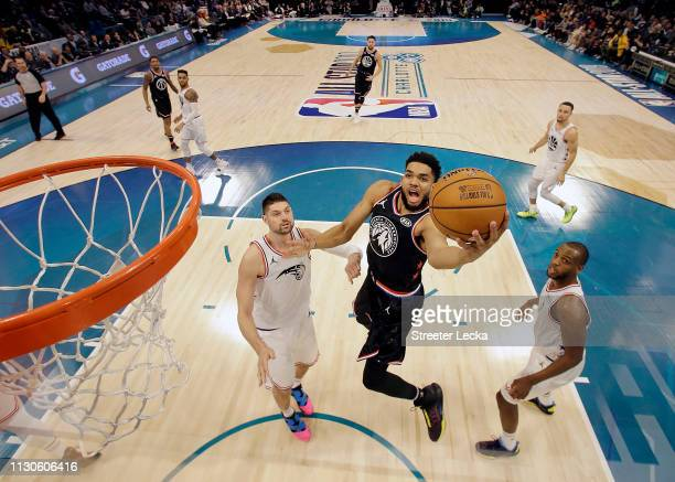 KarlAnthony Towns of the Minnesota Timberwolves and Team LeBron shoots against Nikola Vučević of the Orlando Magic and Team Giannis during the NBA...