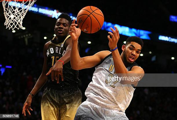 KarlAnthony Towns of the Minnesota Timberwolves and the United States team competes for the ball with Clint Capela of the Houston Rockets and World...
