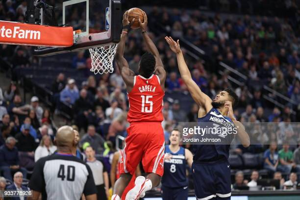 KarlAnthony Towns of the Minnesota Timberwolves blocks the shot against Clint Cappella of the Houston Rocketson March 18 2018 at Target Center in...