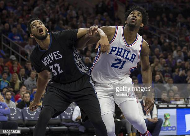KarlAnthony Towns of the Minnesota Timberwolves boxes out Joel Embiid of the Philadelphia 76ers after a foul shot in the first quarter at the Wells...