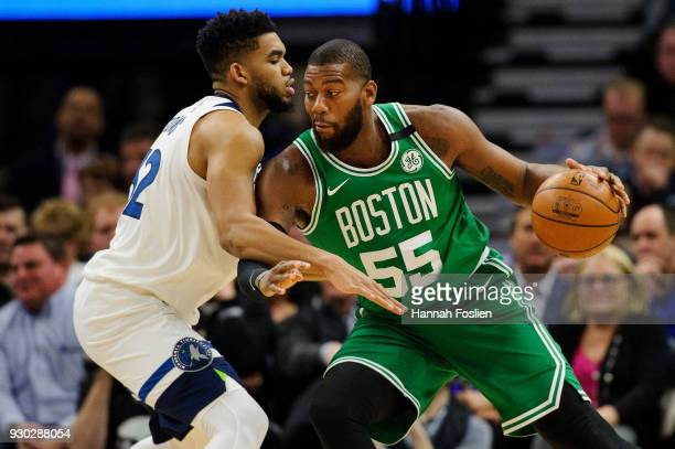 KarlAnthony Towns of the Minnesota Timberwolves defends against Greg Monroe of the Boston Celtics during the game on March 8 2018 at the Target...