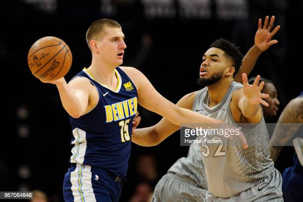 KarlAnthony Towns of the Minnesota Timberwolves defends against Nikola Jokic of the Denver Nuggets during the game on April 11 2018 at the Target...