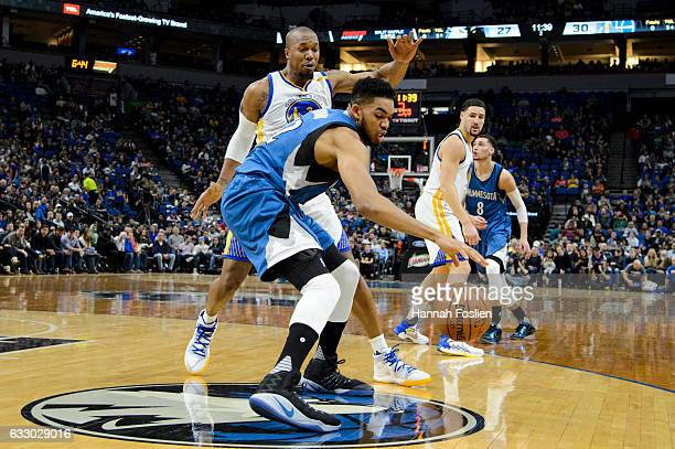 KarlAnthony Towns of the Minnesota Timberwolves dribbles the ball against David West of the Golden State Warriors during the game on December 11 2016...