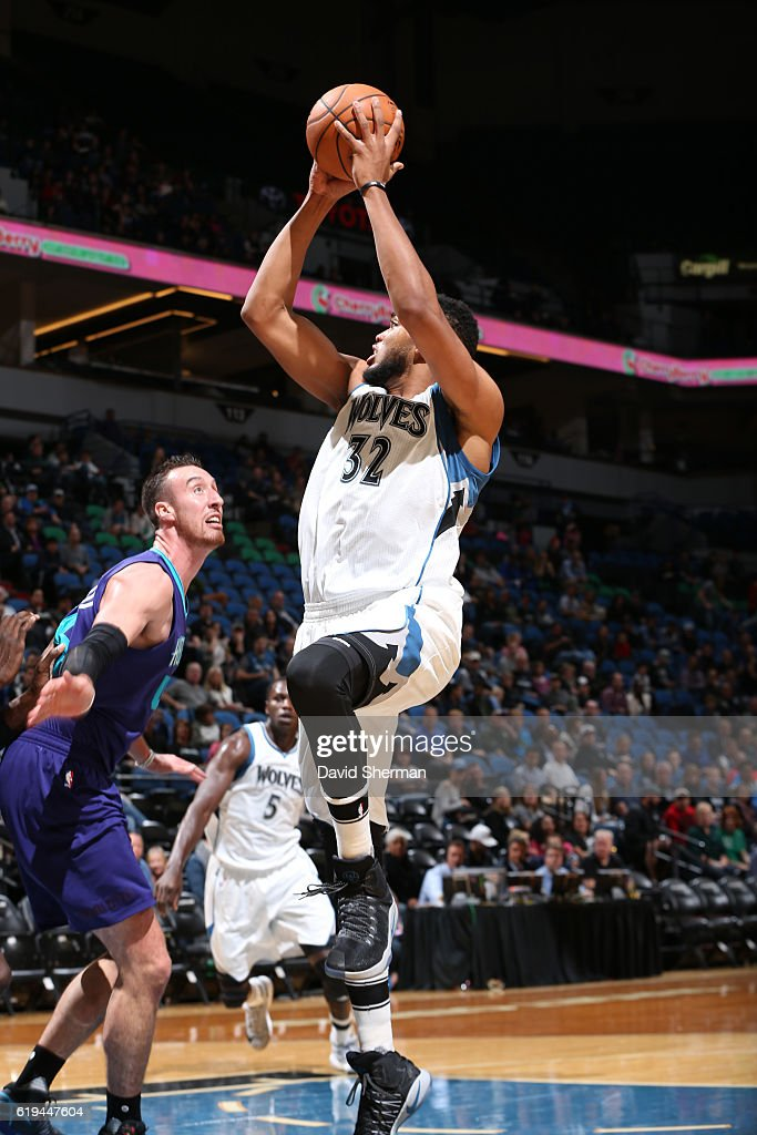 Karl-Anthony Towns #32 of the Minnesota Timberwolves drives to the basket against the Charlotte Hornets during an NBA preseason game on October 21, 2016 at the Target Center in Minneapolis, Minnesota.