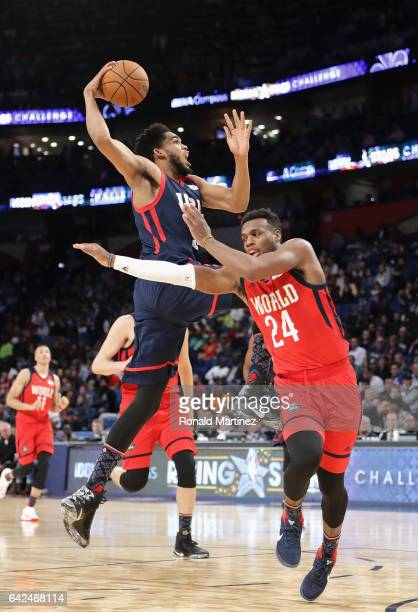KarlAnthony Towns of the Minnesota Timberwolves drives to the basket against Buddy Hield of the New Orleans Pelicans in the second half of the 2017...