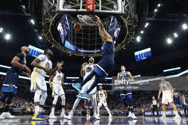KarlAnthony Towns of the Minnesota Timberwolves drives to the basket during the game against the Golden State Warriors on March 11 2018 at Target...