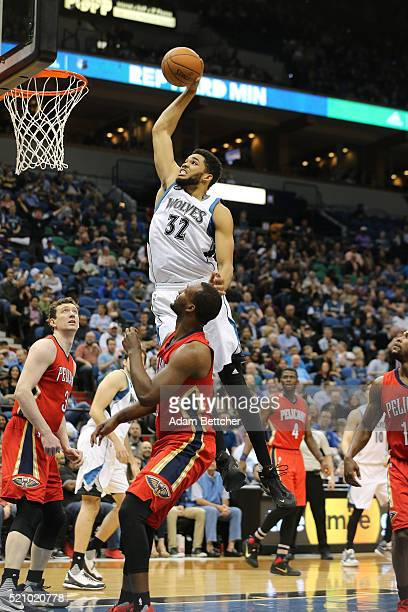 KarlAnthony Towns of the Minnesota Timberwolves dunks on Jordan Hamilton of the New Orleans Pelicans in the second half on April 13 2016 at Target...