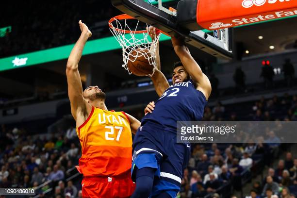 KarlAnthony Towns of the Minnesota Timberwolves dunks the ball in the first quarter while Rudy Gobert of the Utah Jazz defends at Target Center on...