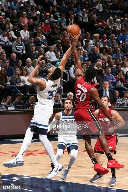 KarlAnthony Towns of the Minnesota Timberwolves goes up for a rebound against Justise Winslow of the Miami Heat on November 24 2017 at Target Center...