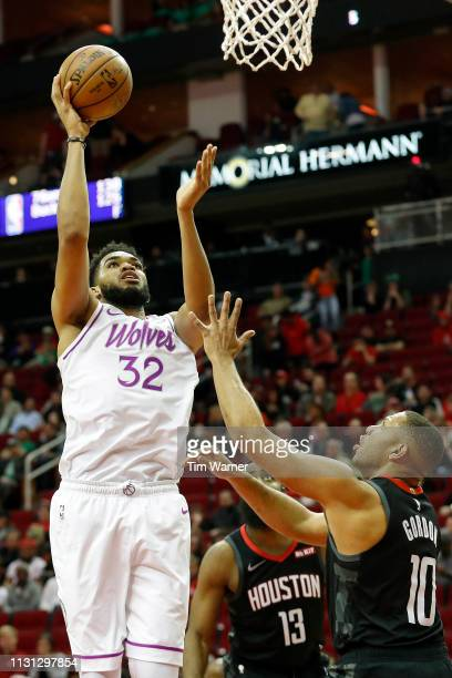 KarlAnthony Towns of the Minnesota Timberwolves goes up for a shot in the second half defended by Eric Gordon of the Houston Rockets at Toyota Center...