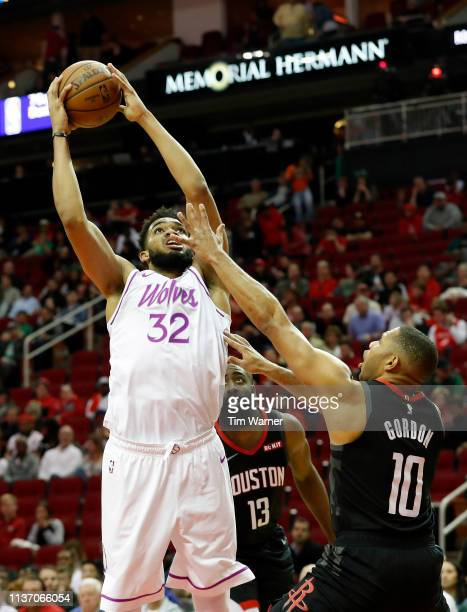 KarlAnthony Towns of the Minnesota Timberwolves goes up for a shot defended by Eric Gordon of the Houston Rockets an James Harden in the second half...