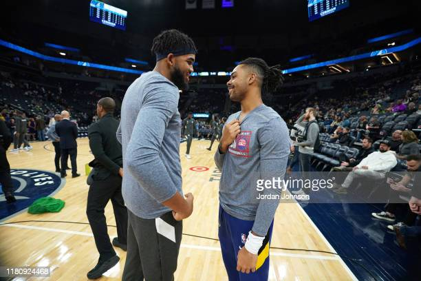 Karl-Anthony Towns of the Minnesota Timberwolves greets D'Angelo Russell of the Golden State Warriors during pregame warmups on November 8, 2019 at...