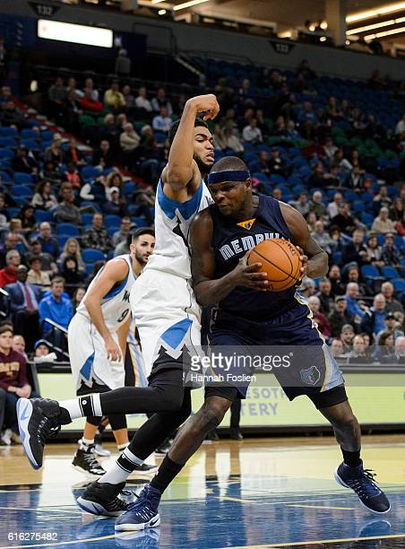 KarlAnthony Towns of the Minnesota Timberwolves guards against Zach Randolph of the Memphis Grizzlies during the preseason game on October 19 2016 at...