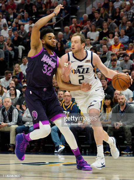 Karl-Anthony Towns of the Minnesota Timberwolves guards Joe Ingles of the Utah Jazz during a game at Vivint Smart Home Arena on March 14, 2019 in...