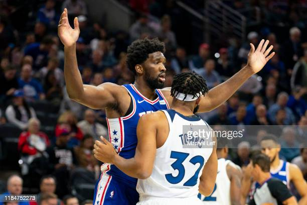 KarlAnthony Towns of the Minnesota Timberwolves guards Joel Embiid of the Philadelphia 76ers at the Wells Fargo Center on October 30 2019 in...