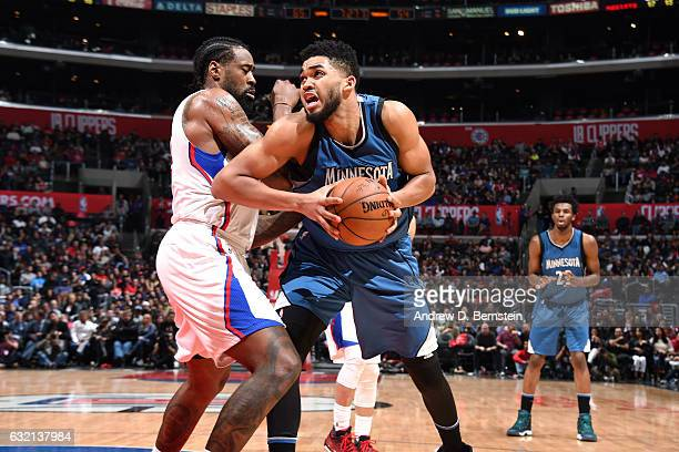 KarlAnthony Towns of the Minnesota Timberwolves handles the ball during the game against DeAndre Jordan of the Los Angeles Clippers on January 19...